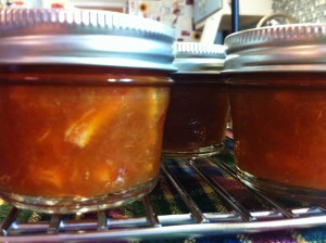 Cooling the jarred marmalade.