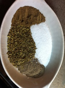 Clockwise from top: ground cumin, salt, black pepper, Mexican oregano