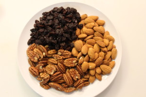 Clockwise: raw Almonds, Pecans, Raisins