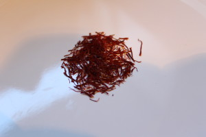 Saffron. The world's most expensive spice (currently about $3000/lb.). It comes fron the stamen of the Crocus flower. It takes approximately 50,000 - 75,000 flowers to make one pound of saffron.   Be sure to buy saffron that is in it's whole form. Don't buy powdered saffron; it's usually cut with turmeric.