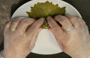 8.  Now, finish rolling the leaf until the stuffing is fully enclosed.