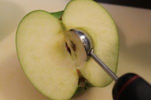 I find using a melon baller very effective for coring apples. Plus, it's safer than either a knife or an apple corer.