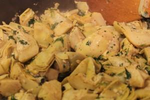Adding the coriander (cilantro).